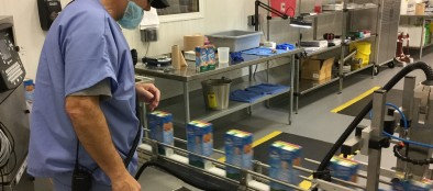 A SunOpta employee oversees a production line of Almond Breeze at the company's Upper Macungie Township facility.